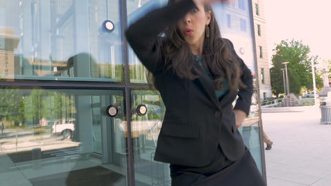 Sexy woman in business attire crazy victory dancing her… Stock Video Footage