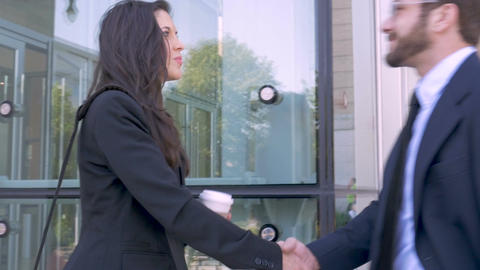 Two professional attractive millennial executive business people shaking hands Footage
