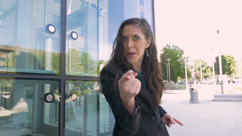 An attractive greedy female millennial business executive screaming and pointing Live Action