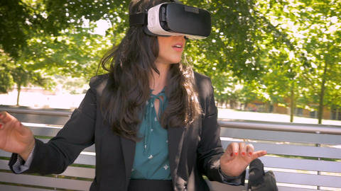 Attractive millennial female office worker in her 30s experiencing augmented 360 Footage