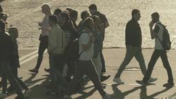 City landscape. Crowd. People cross the street on a pedestrian crossing Footage