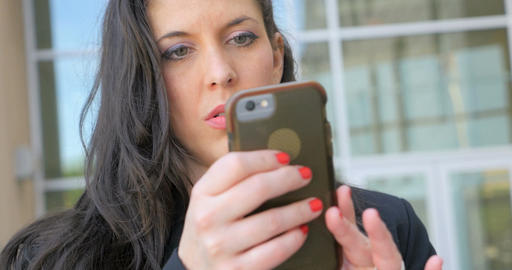 Beautiful serious businesswoman looking at her mobile phone close up shot in 4k Footage