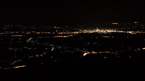 Lights of city night from top view on mountain timelapse ビデオ