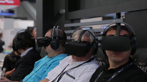 Adult men are immersed in the virtual world Footage