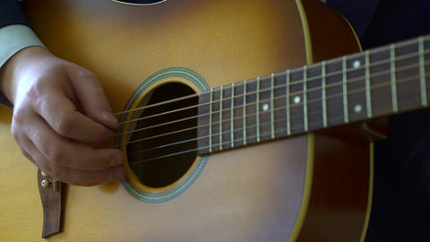 Playing acoustic guitar Live Action