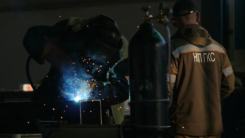 Slow Motion Oil Enterprise Worker Welds Steel Structure Footage