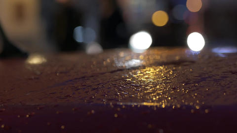 Rainy cars roof reflecting bokeh lights in the evening. Edit sequence Live Action