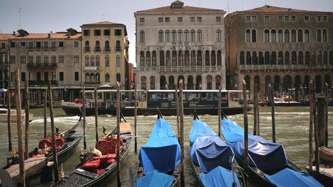 Slow motion taxi boat with gondolas view in Venice Footage