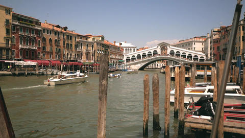 Ponte di Rialto bridge view with boats in Venice Footage