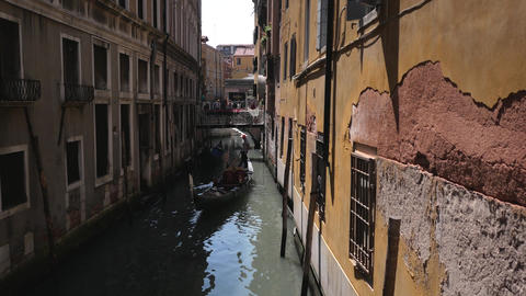 Narrow old street with gondola taxi driver in Venice Footage