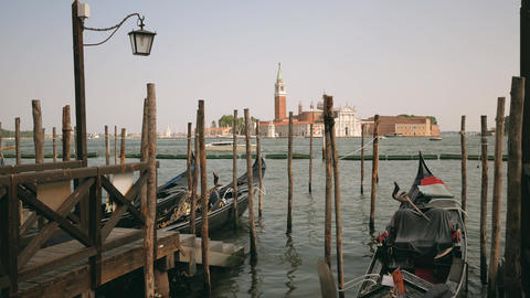 Gondola taxi boats parking place with San Giorgio Maggiore church view Footage