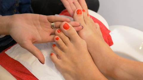 Beautiful pedicure with red nail polish presented for evaluation at nail art ビデオ