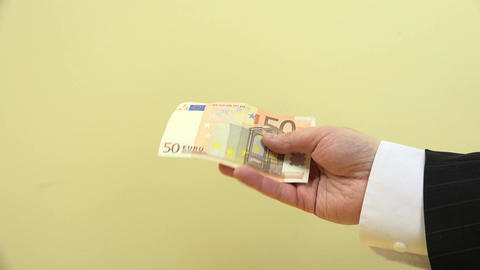 close up of male hand crush 50 euro banknote and throw. 4K Footage