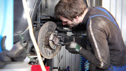 man repairing old rusty car brake system. Service care customer safety Footage