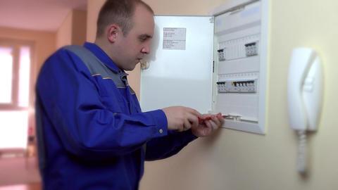 Closeup of electrician repairing circuit breaker Footage