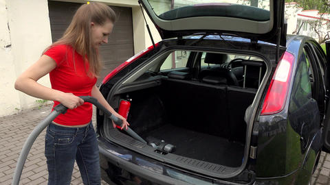 Woman Cleaning Boot Interior Of Car Using Vacuum Cleaner Footage