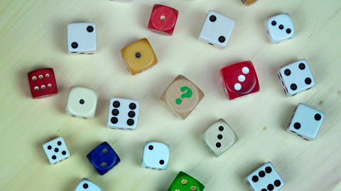 Colorful dices on wooden background. turntable Footage
