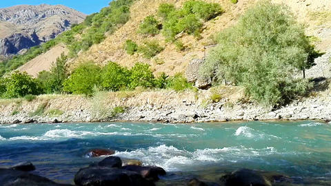 Quick and cool river Ugam in mountain Tashkent Footage
