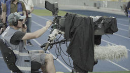 Professional tv cameraman with a camera during TV broadcast at the stadium Footage