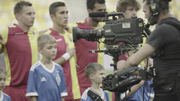 Steadicam cameraman with the camera during the filming of a football team Footage