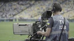 Media. Cameraman with camera. TV Footage