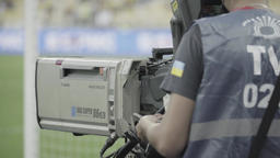 Cameraman with camera shoots sports event at the stadium Footage