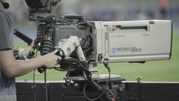 Professional TV camera during TV broadcasting at the stadium Footage