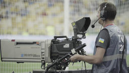 A cameraman during a TV broadcast at the stadium Footage