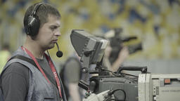 Cameraman with a large professional camera. TV Footage