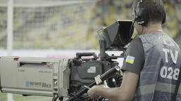 Tv cameraman at work in the stadium. Live. TV broadcast Footage