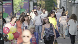 Many people walk down the street during the day. Crowd. Crowded street Footage