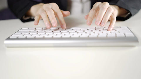 Business woman's hand typing on keyboard computer in office close up ライブ動画