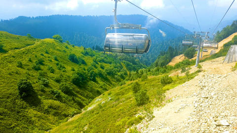 Cabins of the cable car are moving down. Rosa Khutor. Russia Footage