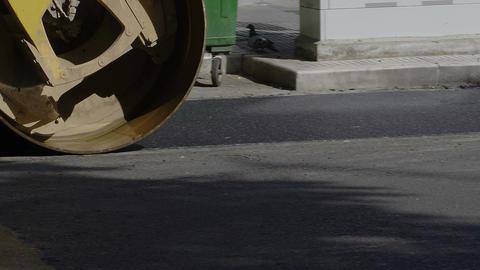 Steamroller presses asphalt at road Image