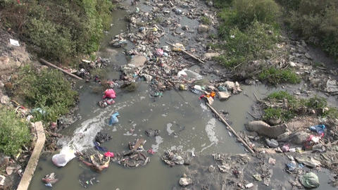 Water pollution in Nepal capital Kathmandu sacred river Bagmati Footage