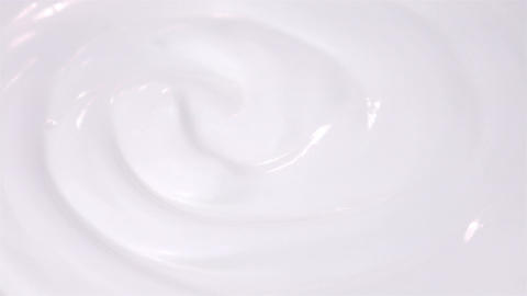 Loopable video of swirling yogurt in 4K Filmmaterial
