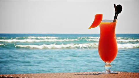 Fruit cocktail on the beach Stock Video Footage
