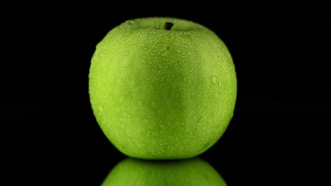 Green apple with water drops Stock Video Footage