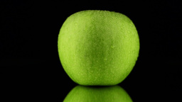 Green apple with water drops Footage