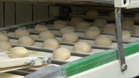 10731 roll bun on conveyor belt dolly close Stock Video Footage