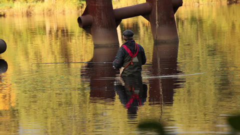fisherman in golden water Stock Video Footage