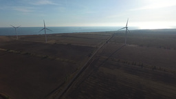 Wind turbines operate at wind farm Footage