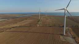 Wind turbines operate at wind farm near the sea, (shooting from the air) Footage
