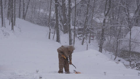 View of a man shoveling snow Live Action