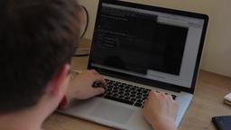 Man typing on laptop Footage