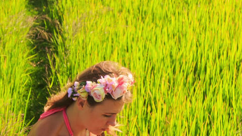 Young Beautiful Lady in Flower Wreath Sits in Green Grass Footage