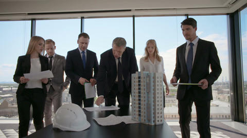 Business meeting of architects and investors Live Action