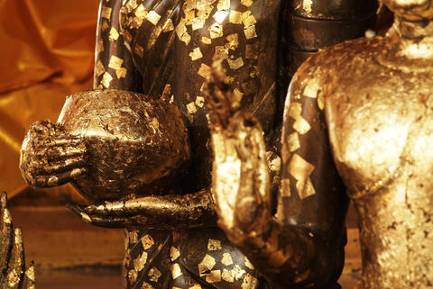 Antique Buddha Statues covered in gold leaf adornment Fotografía
