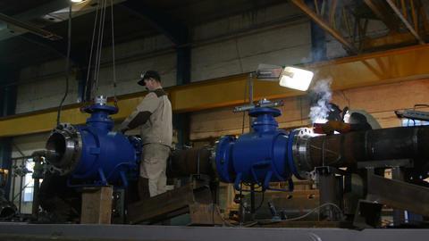 Worker Repairs Equipment Employee Welds Construction Footage