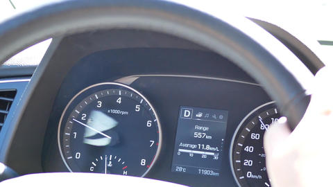 Motion of car tachometer while car driving on road with 4k resolution Footage